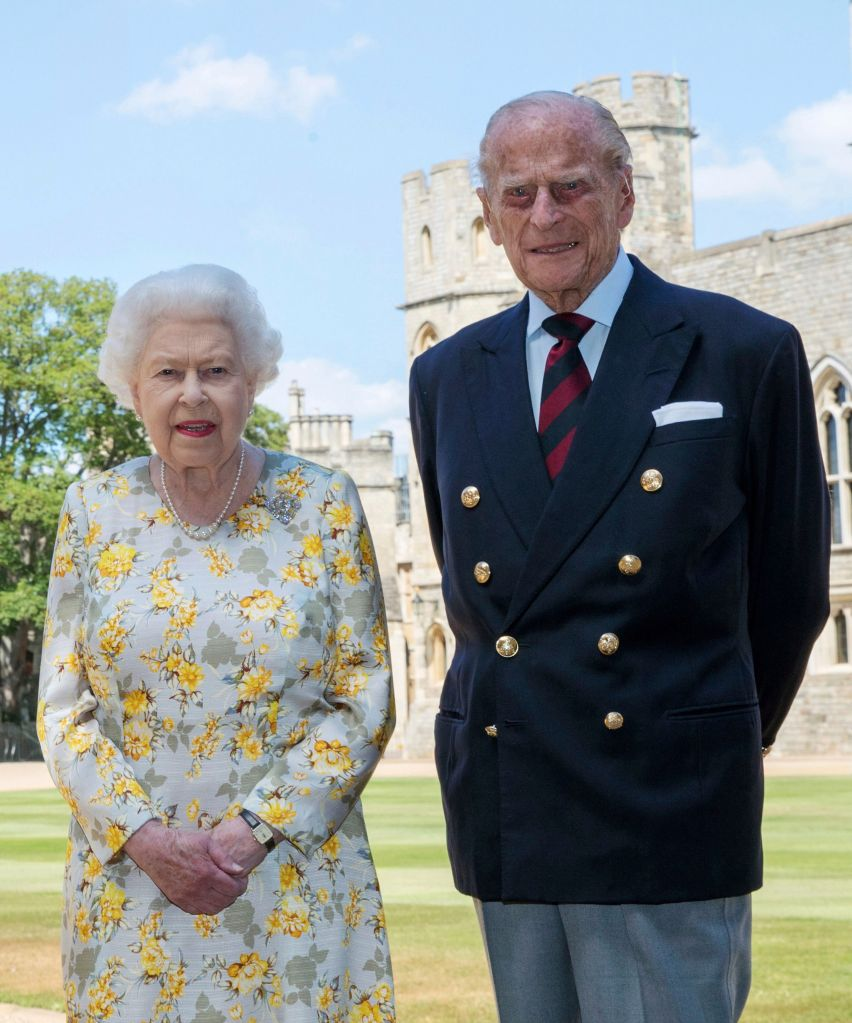 Britain's Queen Elizabeth II and Prince Philip the Duke of Edinburgh pose for a photo June 1, 2020, in the quadrangle of Windsor Castle, in Windsor, England, ahead of his 99th birthday on Wednesday, June 10. The Queen is wearing an Angela Kelly dress with the Cullinan V diamond brooch, while Prince Philip is wearing a Household Division tie. Photo: CP Images/Steve Parsons/Pool via AP