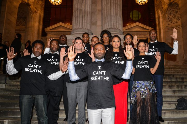 "(L to R) ""Selma"" actors E. Roger Mitchell, Wendell Pierce, Omar Dorsey, John Lavelle, Stephan James, Kent Faulcon, David Oyelowo, Lorraine Toussaint, director Ava DuVernay, Tessa Thompson, Andre Holland, and Colman Domingo wear ""I Can't Breathe"" t-shirts to protest the death of Eric Garner at the New York Public Library on December 14, 2014 in New York City.  (Photo by Ray Tamarra/GC Images)"