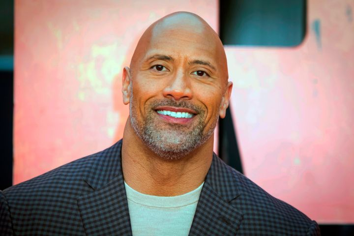 Dwayne Johnson poses for photographer. Photo: THE CANADIAN PRESS/AP-Photo by Vianney Le Caer/Invision/AP, File