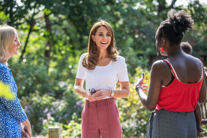 Britain's Kate, the Duchess of Cambridge, centre smiles, during a visit to Battersea Park, as she met up with mothers, in London, Tuesday, Sept. 22, 2020. (Jack Hill/Pool Photo via AP/CP Images)
