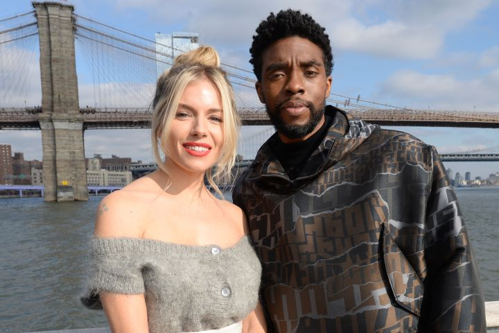 Sienna Miller and Chadwick Boseman. Photo: Brad Barket/Getty Images for STXfilms