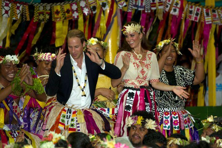 Prince William and Kate Middleton dance with local ladies at a Vaiku Falekaupule Ceremony in Funafuti, Tuvalu.