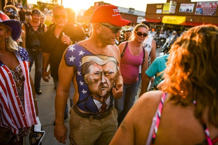 A man shows off his chest painted with a portrait of President Donald Trump during the 80th Annual Sturgis Motorcycle Rally on Aug. 7, 2020, in Sturgis, S.D. Michael Ciaglo/Getty Images
