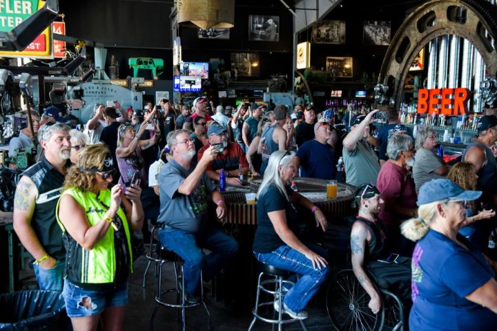 People watch a concert at the Full Throttle Saloon during the 80th Annual Sturgis Motorcycle Rally in Sturgis, S.D. on Aug. 9, 2020. Michael Ciaglo/Getty Images