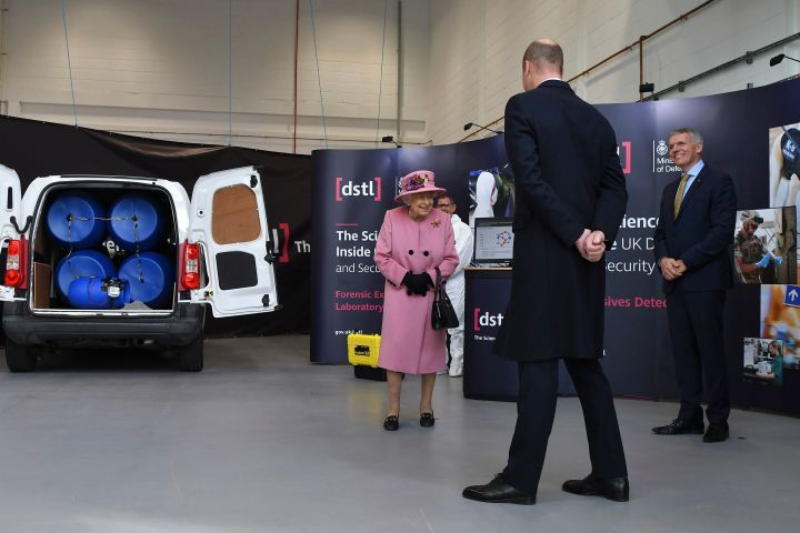 Britain's Queen Elizabeth II, Prince William and Chief Executive Gary Aitkenhead, right, view a demonstration of a Forensic Explosives Investigation, with a model explosive device in a vehicle, during a visit to the Defence Science and Technology Laboratory (DSTL) at Porton Down, England (Ben Stansall/Pool via AP/CP Images)