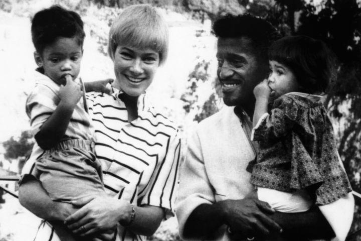 May Britt, left, and Sammy Davis, Jr., with their children (from left) Mark Davis and Tracey Davis, 1962