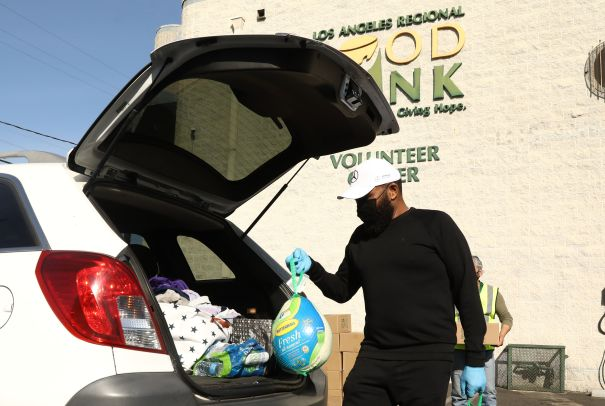 Anthony Anderson Hands Out Turkeys In L.A. Ahead Of U.S. Thanksgiving
