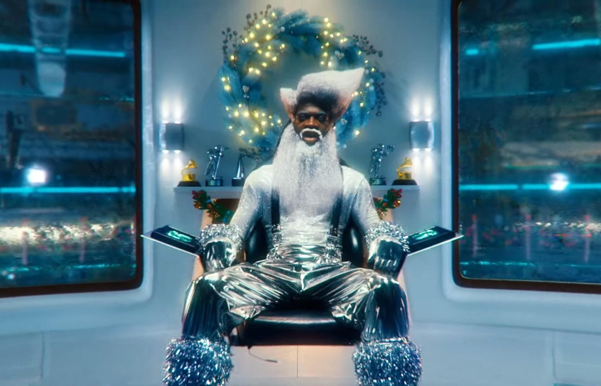 Lil Nas X Transforms Into Futuristic Santa Claus In New 'Holiday' Music Video | ETCanada.com