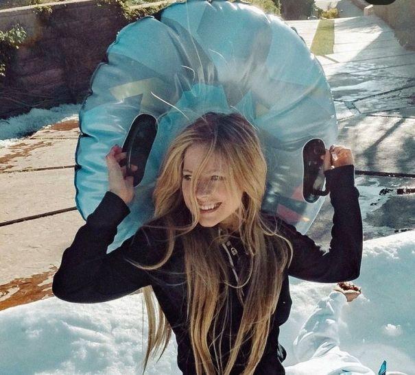 Avril Lavigne Slides Into Christmas