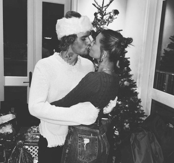 Justin And Hailey Bieber Share A Christmas Kiss