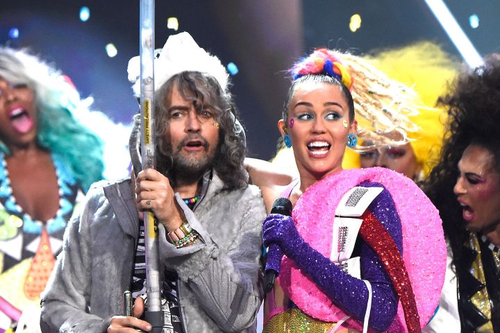 Wayne Coyne and Miley Cyrus. Photo: Kevin Mazur/MTV1415/WireImage/Getty Images