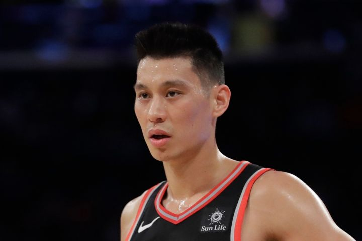 """FILE - In this March 28, 2019, file photo, Toronto Raptors' Jeremy Lin stands on the court during the second half of the team's NBA basketball game against the New York Knicks in New York. Golden State Warriors coach Steve Kerr will support G League guard Lin and is hopeful of an investigation into what discriminatory act caused Lin to speak out about racism facing Asian Americans. In a heartfelt social media post, Lin didn't go into specifics about what happened except to reference he had been called """"coronavirus"""" on the court. (AP Photo/Frank Franklin II, File)"""