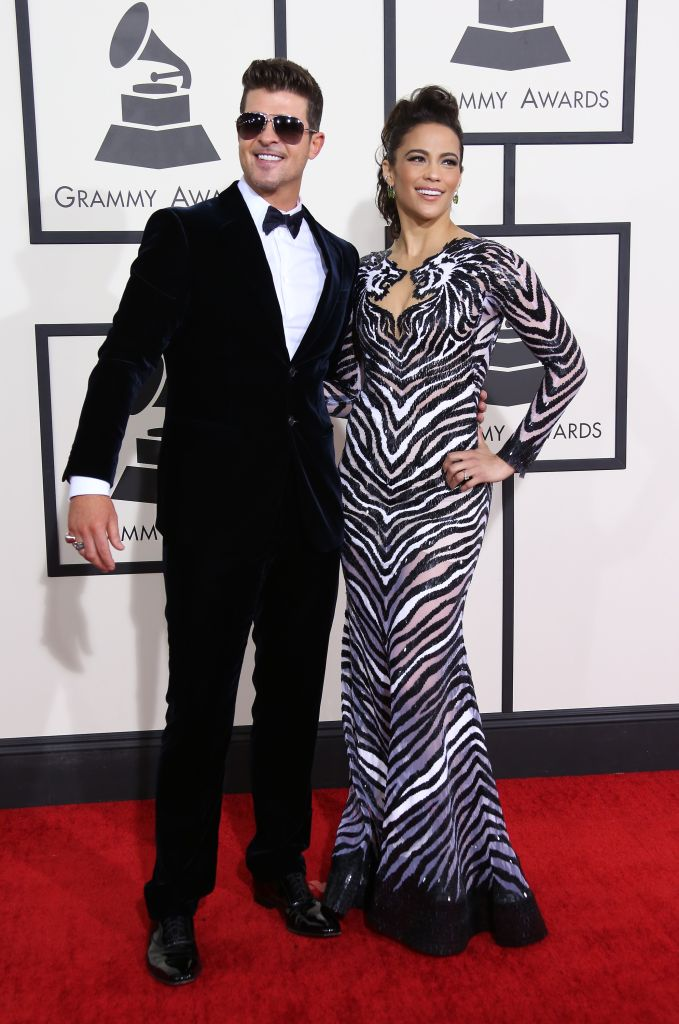 Robin Thicke and Paula Patton arrive at the 56th Annual GRAMMY Awards at Staples Center on January 26, 2014 in Los Angeles, California. (Photo by Dan MacMedan/WireImage/Getty)