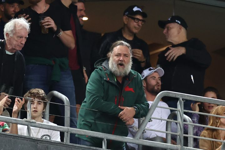 Actors Chris Hemsworth, Jeff Goldblum and Russell Crowe watch the round three NRL match between the South Sydney Rabbitohs and the Sydney Roosters at Stadium Australia on March 26, 2021, in Sydney, Australia.