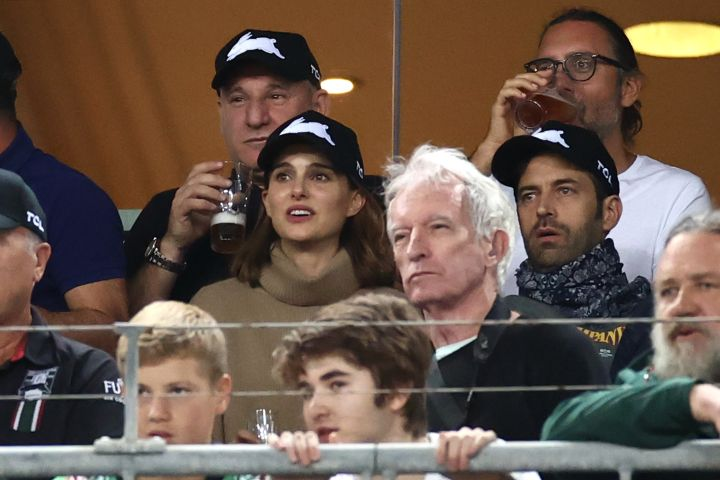 Natalie Portman with her husband Benjamin Millepied watch the round three NRL match between the South Sydney Rabbitohs and the Sydney Roosters at Stadium Australia on March 26, 2021, in Sydney, Australia.