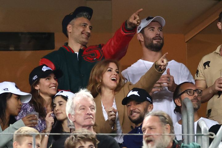 Taika Waititi, Chris Hemsworth, Elsa Pataky, Isla Fisher and Russell Crowe watch the round three NRL match between the South Sydney Rabbitohs and the Sydney Roosters at Stadium Australia on March 26, 2021, in Sydney, Australia.