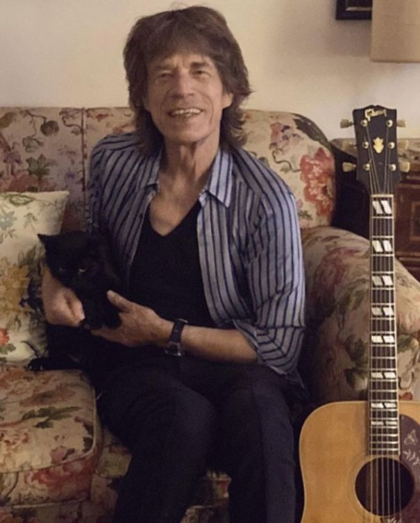 Mick Jagger Shows Off His 'Camera Shy' Kitty
