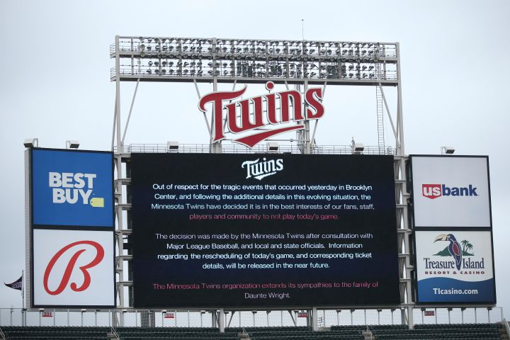 The scoreboard at Target Field explains the postponement of the baseball game between the Minnesota Twins and Boston Red Sox on Monday, April 12, 2021, in Minneapolis. The Minnesota Twins have postponed their game against the Boston Red Sox because of safety concerns following the fatal police shooting of a Black man in a nearby suburb.