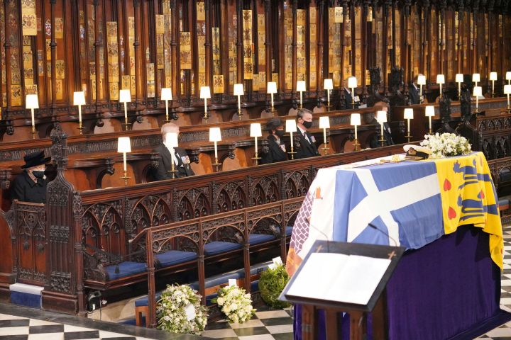 Queen Elizabeth II, Prince Andrew, Princess Anne the Princess Royal and Vice Admiral Timothy Laurence look on the flag draped coffin in St. George's Chapel during the funeral of Prince Philip. Photo: Jonathan Brady/Pool via AP/CPImages