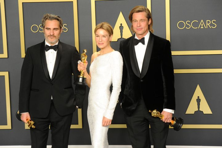 Joaquin Phoenix, Renée Zellweger and Brad Pitt pose inside The Press Room of the 92nd Annual Academy Awards held at Hollywood and Highland on February 9, 2020 in Hollywood, California.