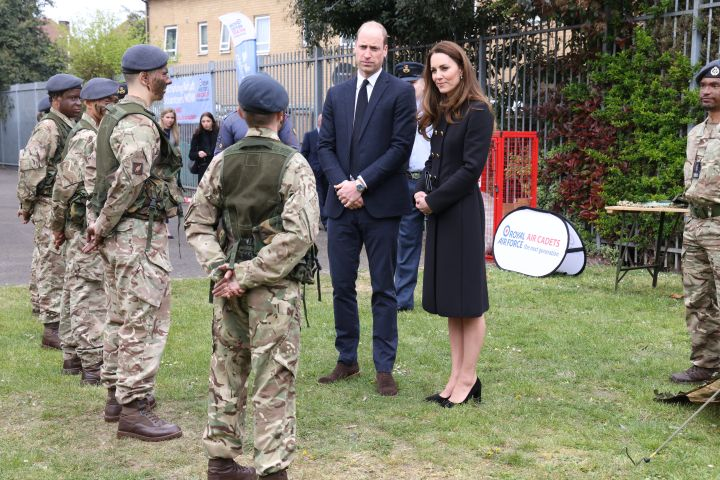 Prince William, Duke of Cambridge and Catherine, Duchess of Cambridge, wearing black as a mark of respect following the Duke of Edinburgh's passing, visit 282 East Ham Squadron, Air Training Corps in East London on April 21, 2021 in London, England.