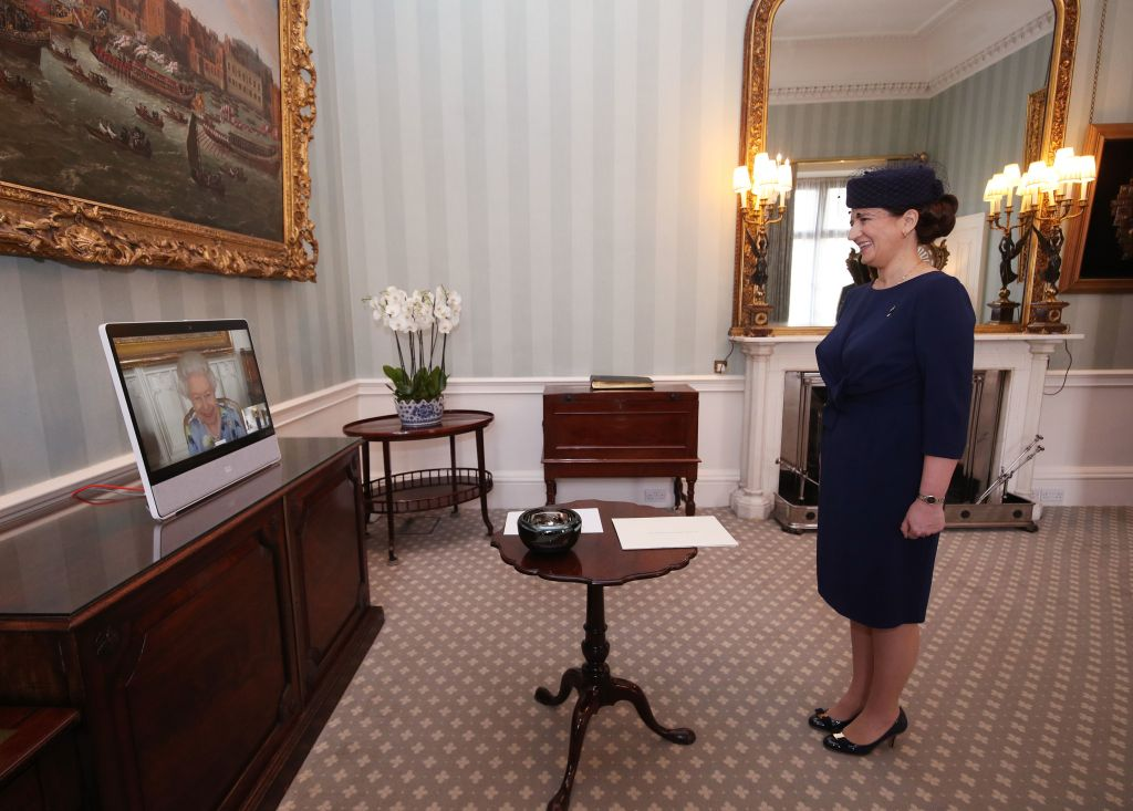 Queen Elizabeth II appears on a screen by videolink from Windsor Castle, where she is in residence, during a virtual audience to receive Her Excellency Ivita Burmistre, the Ambassador of Latvia, at Buckingham Palace on April 27, 2021, in London, England. (Photo by Yui Mok – Pool/Getty Images)