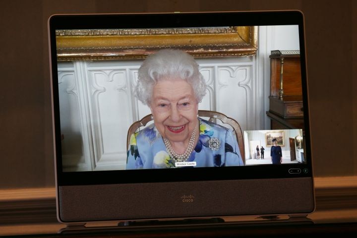 Queen Elizabeth II appears on a screen by videolink from Windsor Castle, where she is in residence, during a virtual audience to receive Her Excellency Ivita Burmistre, the Ambassador of Latvia at Buckingham Palace on April 27, 2021 in London, England.