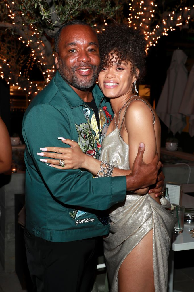 """Andra Day hugs it out with her """"The United States vs. Billie Holiday"""" director Lee Daniels. Photo: Jerritt Clark/Getty Images for Bassline Management"""
