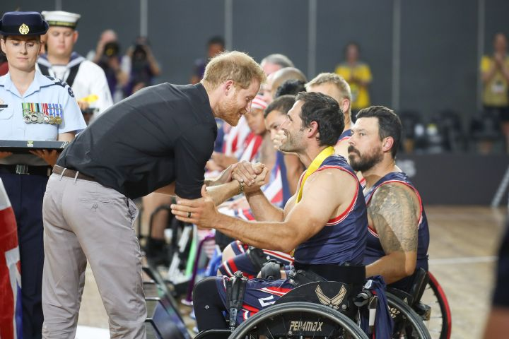 Prince Harry, Duke of Sussex, congratulating the United States team in the Wheelchair Basketball after winning Gold in the finals during Day 8 of the Invictus Games Sydney 2018.
