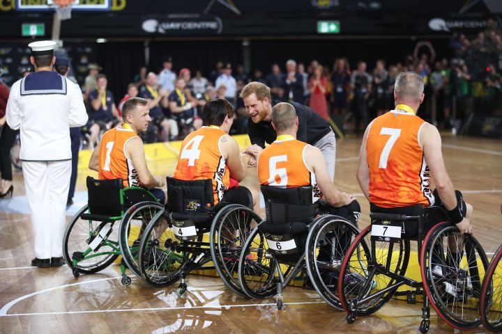 Prince Harry, Duke of Sussex congratulates the silver medallists from the Netherlands after the Wheelchair Basketball gold medal match during Day 8 of the Invictus Games Sydney 2018.