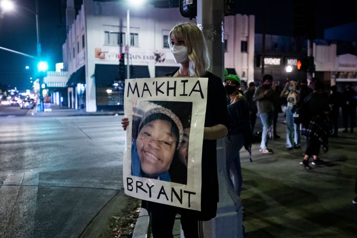 Mandatory Credit: Photo by ETIENNE LAURENT/EPA-EFE/Shutterstock (11868829a) A protester holds a poster displaying the portrait of Ma'Khia Bryant as people gathered to the news that former Minneapolis police officer Derek Chauvin was found guilty of all three charges in the murder of George Floyd in Los Angeles, California, USA, 20 April 2021. 16-year-old Ma'Khia Bryant was shot by a Columbus police officer outside of her home after she allegedly called the police for help. The shooting happened as the jury in Derek Chauvin was delivering the verdict. Reactions to Derek Chauvin trial verdict, in Los Angeles, USA - 20 Apr 2021