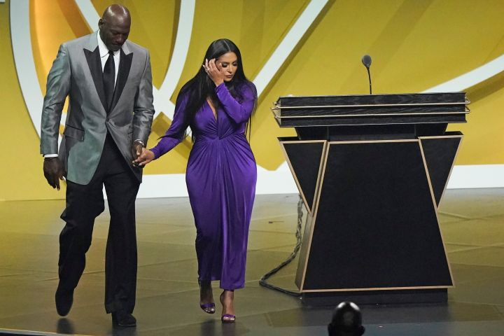 Michael Jordan escorts Vanessa Bryant off the stage after Bryant's late husband, Kobe Bryant, was enshrined as part of the 2020 Basketball Hall of Fame.