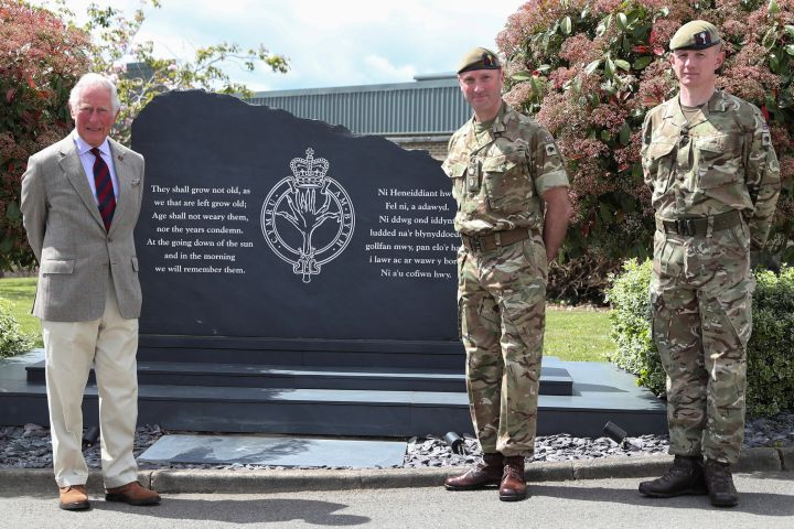 Prince Charles, Prince of Wales poses next to a memorial during a visit to the Welsh Guards at Combermere Barracks on May 5, 2021 in Windsor, England. Photo: Peter Cziborra – WPA Pool/Getty Images