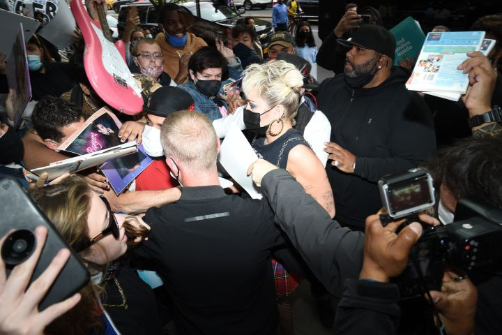 Miley Cyrus is surrounded by fans in SoHo on May 6, 2021.