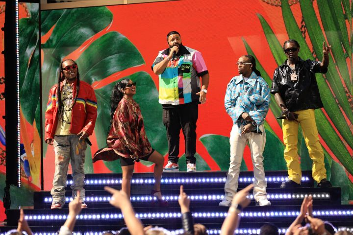 Takeoff of Migos, H.E.R., DJ Khaled, and Quavo and Offset of Migos perform on stage during the 2021 Billboard Music Awards.