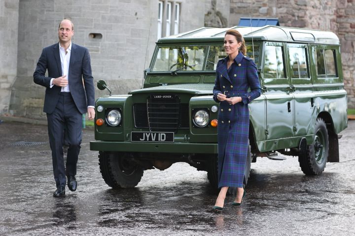 The Duke and Duchess of Cambridge complemented each other with their looks for the night with William in a navy suit and Kate in a long navy plaid coat.  In tribute, the pair watched the film from the Land Rover Defender that previously belonged to the late Prince Philip.