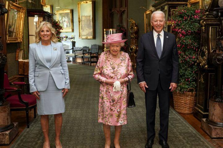 Britain's Queen Elizabeth II with US President Joe Biden and First Lady Jill Biden in the Grand Corridor at Windsor Castle.