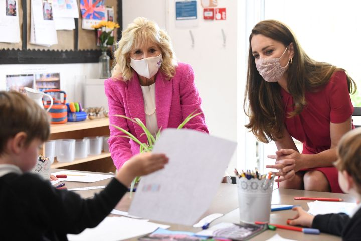 Britain's Catherine, Duchess of Cambridge and U.S. First Lady Jill Biden chat with children during their visit to Connor Downs Academy in Hayle, Cornwall on the sidelines of the G7 summit on June 11, 2021.