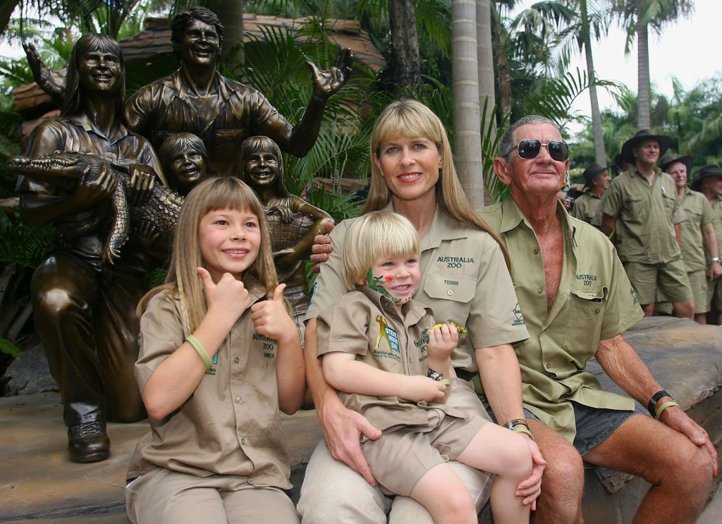 """(L-R) Bindi, Robert, Terri and Bob Irwin pose in front of a statue of the family that was unveiled during """"Steve Irwin Memorial Day"""" at Australia Zoo on November 15, 2007 on the Sunshine Coast, Australia. (Photo by Bradley Kanaris/Getty Images)"""
