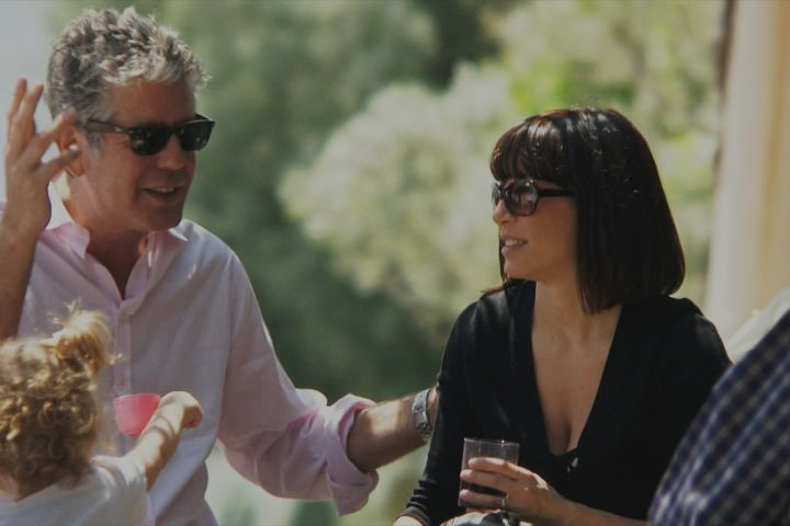 """Anthony Bourdain (left) and Ottavia Busia-Bourdain (right) star in Morgan Neville's documentary, """"Roadrunner"""", a Focus Features release. Courtesy of Discovery Access / Focus Features"""