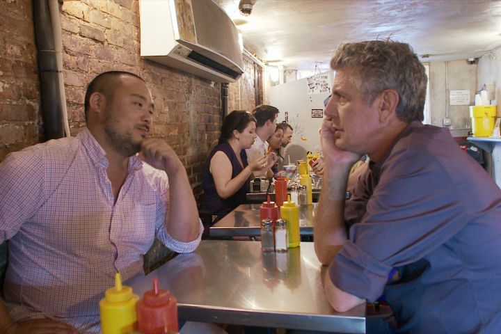 """David Chang (left) and Anthony Bourdain (right) star in Morgan Neville's documentary, """"Roadrunner"""", a Focus Features release. Courtesy of Focus Features, in association with Zero Point Zero"""