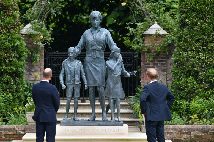 Britain's Prince William, left and Prince Harry unveil a statue they commissioned of their mother Princess Diana, on what would have been her 60th birthday, in the Sunken Garden at Kensington Palace, London, Thursday July 1, 2021. (Dominic Lipinski /Pool Photo via AP/CP Images)