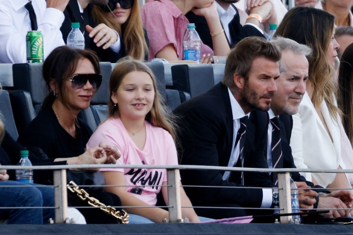 David Beckham, Victoria Beckham and their daughter Harper Beckham attend the game between Inter Miami FC and the Los Angeles Galaxy at DRV PNK Stadium on April 18, 2021 in Fort Lauderdale, Florida.