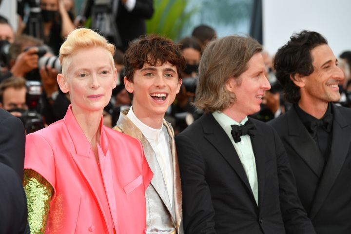 """Tilda Swinton, Timothée Chalamet, Wes Anderson and Adrien Brody attend the """"The French Dispatch"""" screening during the 74th annual Cannes Film Festival"""