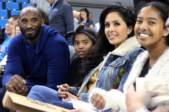 Kobe Bryant, his daughter Gianna Maria-Onore Bryant, wife Vanessa and daughter Natalia Diamante Bryant are seen before an NCAA college women's basketball game