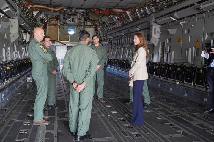 Catherine, Duchess of Cambridge stands in the fuselage of an RAF C17 Globemaster as she meets those who supported the U.K.'s evacuation of civilians from Afghanistan at RAF Brize Norton. (Photo by Steve Parsons – WPA Pool/Getty Images)