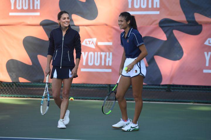 Catherine, Duchess of Cambridge plays a game of tennis with U.S. Open Champion Emma Raducanu.