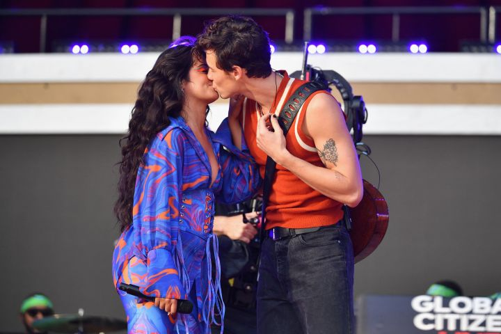 US-Cuban singer-songwriter Camila Cabello (L) and Canadian singer-songwriter Shawn Mendes kiss as they perform during the 2021 Global Citizen Live festival at the Great Lawn, Central Park on September 25, 2021 in New York City. (Photo by Angela Weiss / AFP) (Photo by )