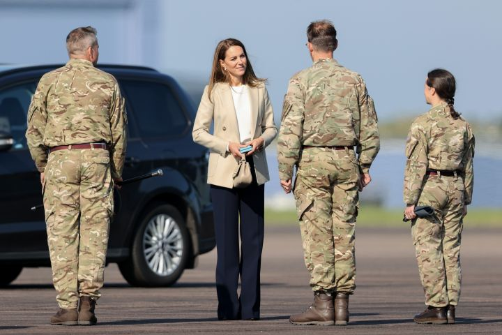 Catherine, Duchess of Cambridge speaks with those who supported the U.K.'s evacuation of civilians from Afghanistan at RAF Brize Norton.