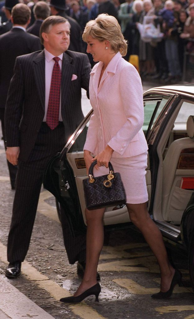 Diana Princess Of Wales carrying a black Dior handbag. Photo: Tim Graham Photo Library via Getty Images